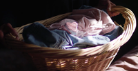 Close Up Of Old Lady Holding Her Laundry Basket
