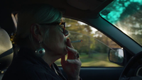 Close Up Of Old Lady Driving And Smoking