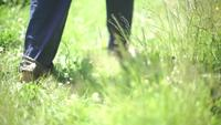 Feet walking on a meadow