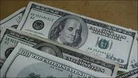 Rotating stock footage shot of $100 bills - MONEY 0147