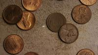 Rotating stock footage shot of American pennies (coin - $0.01) - MONEY 0159