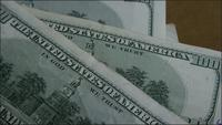 Rotating stock footage shot of $100 bills - MONEY 0151