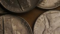 Rotating stock footage shot of American nickles (coin - $0.05) - MONEY 0198