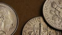 Rotating stock footage shot of American dimes (coin - $0.10) - MONEY 0206