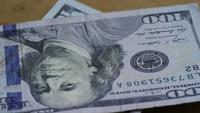 Rotating stock footage shot of $100 bills - MONEY 0135