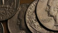 Rotating stock footage shot of American quarters (coin - $0.25) - MONEY 0242