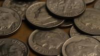 Rotating stock footage shot of American dimes (coin - $0.10) - MONEY 0213