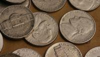 Rotating stock footage shot of American nickles (coin - $0.05) - MONEY 0199