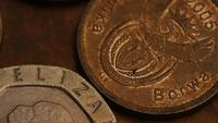 Rotating stock footage shot of international monetary coins - MONEY 0371