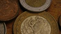 Rotating stock footage shot of international monetary coins - MONEY 0366