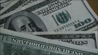 Rotating stock footage shot of $100 bills - MONEY 0154