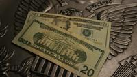 Rotating stock footage shot of American paper currency on an American eagle shield background - MONEY 0395