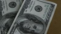Rotating stock footage shot of $100 bills - MONEY 0152