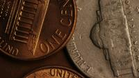 Rotating stock footage shot of American monetary coins - MONEY 0288