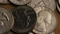 Rotating stock footage shot of American quarters (coin - $0.25) - MONEY 0240