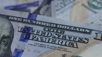 Rotating stock footage shot of $100 bills - MONEY 0137