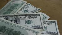 Rotating stock footage shot of $100 bills - MONEY 0146