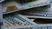 Rotating stock footage shot of $100 bills - MONEY 0138