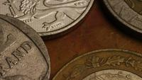 Rotating stock footage shot of international monetary coins - MONEY 0368
