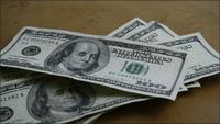 Rotating stock footage shot of $100 bills - MONEY 0145