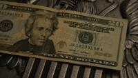 Rotating stock footage shot of American paper currency on an American eagle shield background - MONEY 0397