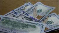 Rotating stock footage shot of $100 bills - MONEY 0143