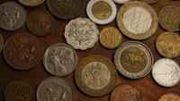 Rotating stock footage shot of international monetary coins - MONEY 0384