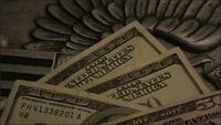Rotating stock footage shot of American paper currency on an American eagle shield background - MONEY 0406