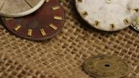 Rotating stock footage shot of antique and weathered watch faces - WATCH FACES 019
