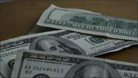 Rotating stock footage shot of $100 bills - MONEY 0156