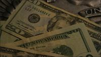 Rotating stock footage shot of American paper currency on an American eagle shield background - MONEY 0404