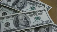 Rotating stock footage shot of $100 bills - MONEY 0149