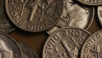 Rotating stock footage shot of American dimes (coin - $0.10) - MONEY 0205