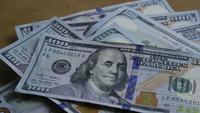Rotating stock footage shot of $100 bills - MONEY 0142