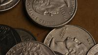 Rotating stock footage shot of American quarters (coin - $0.25) - MONEY 0234