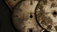 Rotating stock footage shot of antique and weathered watch faces - WATCH FACES 008