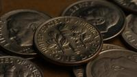 Rotating stock footage shot of American dimes (coin - $0.10) - MONEY 0215