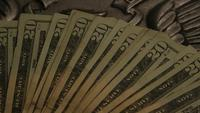 Rotating stock footage shot of American paper currency on an American eagle shield background - MONEY 0402
