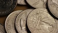 Rotating stock footage shot of American quarters (coin - $0.25) - MONEY 0228