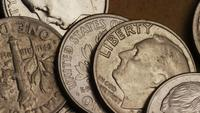 Rotating stock footage shot of American dimes (coin - $0.10) - MONEY 0204
