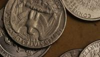 Rotating stock footage shot of American quarters (coin - $0.25) - MONEY 0238