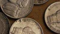 Rotating stock footage shot of American nickles (coin - $0.05) - MONEY 0201