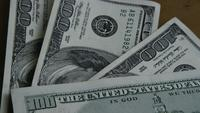 Rotating stock footage shot of $100 bills - MONEY 0153