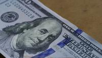 Rotating stock footage shot of $100 bills - MONEY 0134