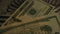 Rotating stock footage shot of American paper currency on an American eagle shield background - MONEY 0405