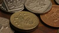 Rotating stock footage shot of international monetary coins - MONEY 0364