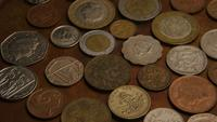 Rotating stock footage shot of international monetary coins - MONEY 0386