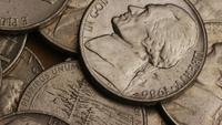 Rotating stock footage shot of American nickles (coin - $0.05) - MONEY 0202