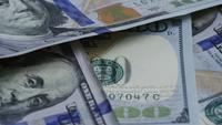 Rotating stock footage shot of $100 bills - MONEY 0131