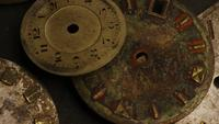 Rotating stock footage shot of antique and weathered watch faces - WATCH FACES 004